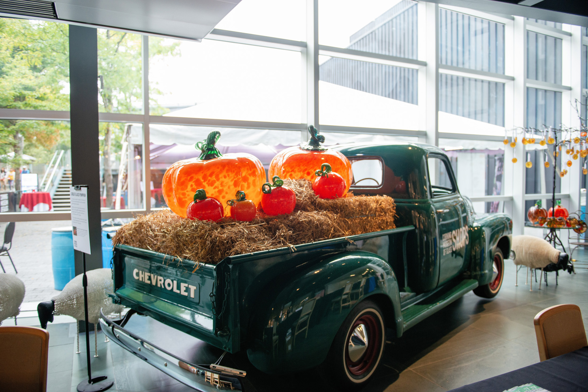 Happy truck full of glass pumpkins at hte Corning Museum of Glass